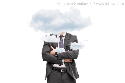 Businessman hidden behind a few small clouds